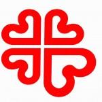 Logotipo de Cáritas. Cuatro corazones rojos unidos por el vértice. Los vértices quedan en el centro. La silueta del conjunto forma una cruz. El corazón inferior derecho es algo más grande que el resto.